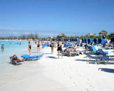 Cruise passengers are relaxing and having a great time on the beach.